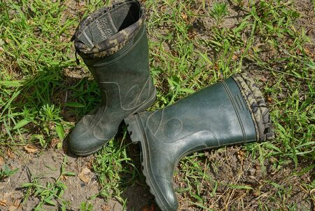 two green rubber boots