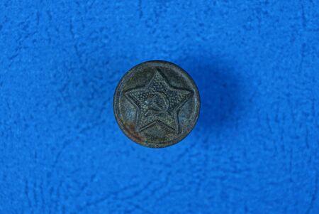 one old brown soviet button