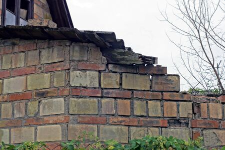 part of an old ruined house from a brown brick wall