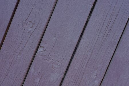Brown lilac wooden texture of old fence boards