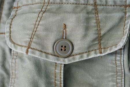 piece of cotton clothes with a pocket and a brown button Stockfoto