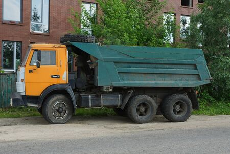 one big old color truck stands on the pavement on the road