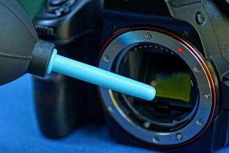 plastic pear cleans the matrix on a black camera