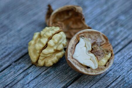 pieces of walnuts lie on a gray wooden table