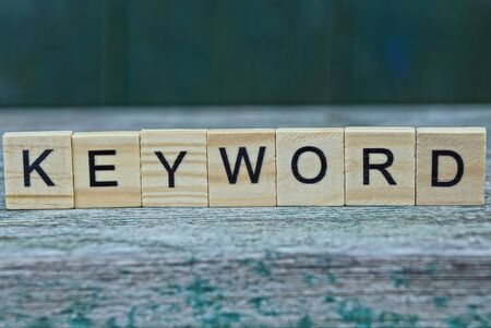 keyword brown wood letters on gray table Stok Fotoğraf