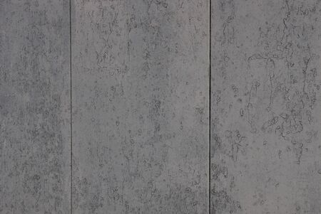 gray metal background of shabby paint on the wall