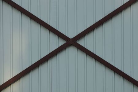 metal texture of gray iron wall and brown bars Stok Fotoğraf