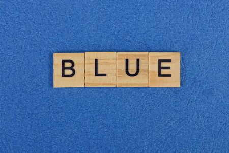word blue made from brown wooden letters lies on the table