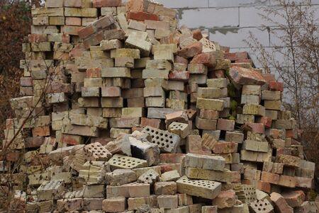 big pile of old brown bricks on the street