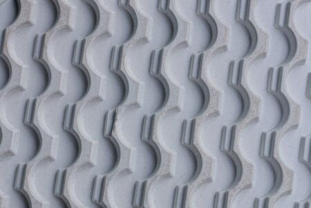 gray texture of a piece of plastic sole with a pattern