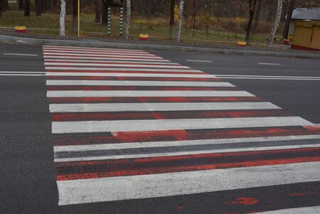 gray asphalt road with white and red markings 스톡 콘텐츠