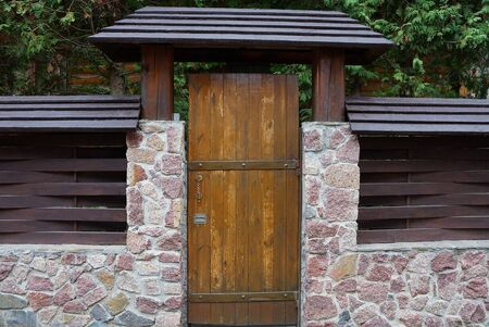 one large closed brown door made of wooden boards