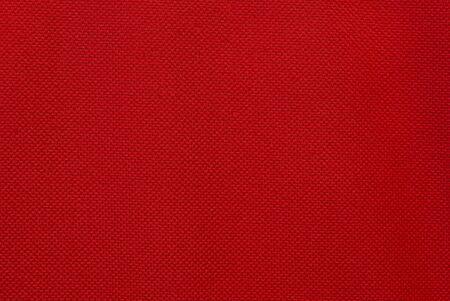 leuchtend rote Textur aus einem Stück Stoff