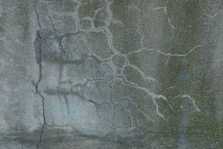 gray stone texture from an old concrete wall with cracks