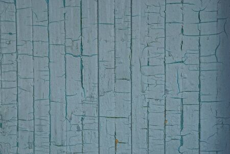 gray shabby paint texture with cracks on an old wall