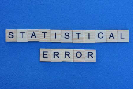 phrase statistical error made from gray wooden letters lies on a blue background