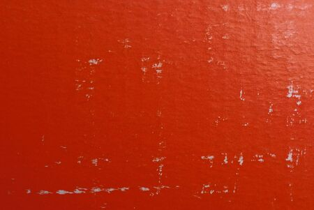 red paper texture with white scuffs on an piece of cardboard