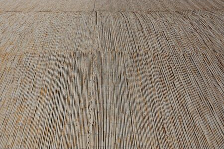 brown wooden texture of rods of dry cane on the roof