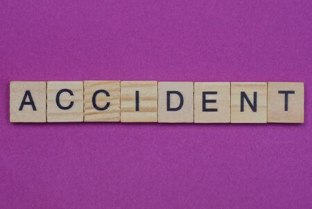 word accident from wooden letters lies red backgound