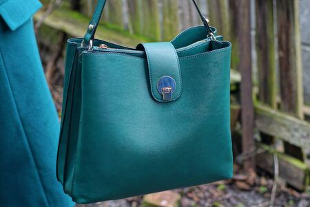 one big closed green leather bag hanging on the street Archivio Fotografico
