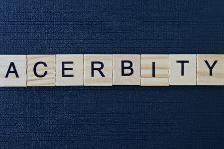 text the word acerbity from gray wooden letters on a black table Standard-Bild - 146608844