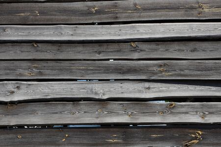 gray black wooden texture of old boards in a fence