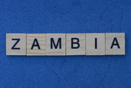name of the country of zambia from the word from gray wooden letters on a blue table Standard-Bild - 146751142