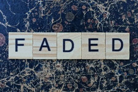 text the word faded from gray wooden small letters with black font Standard-Bild