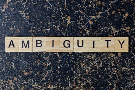 text the word ambiguity from gray wooden small letters with black font Stock Photo