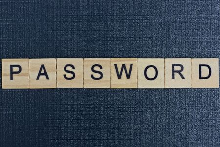 text on word password from gray wooden letters on a black background