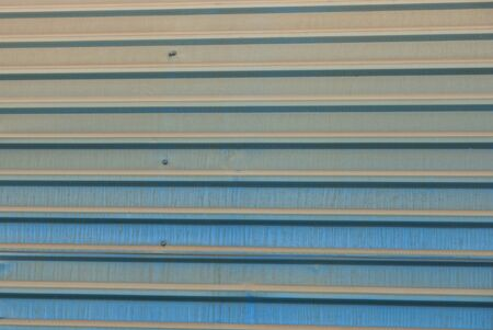 blue gray metal striped texture from old iron wall