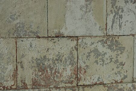 gray brown stone texture from old shabby concrete blocks in the wall