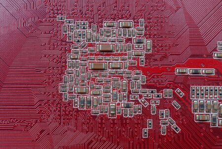 part of a red microcircuit board with small gray details