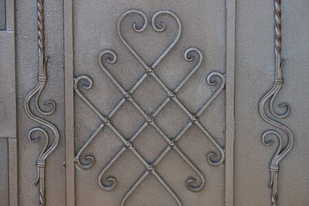 gray brown metal texture of iron wall and twigs in a pattern
