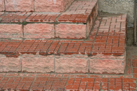 stone texture of brown concrete steps with wet paving tiles on the street Stockfoto