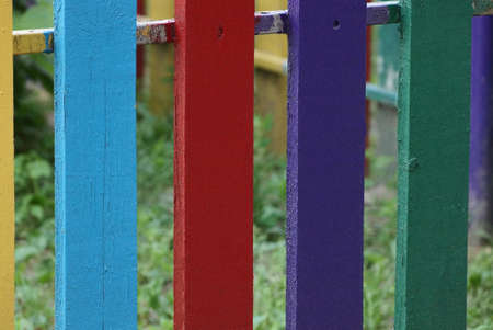 colored wooden texture from a number of boards in the fence wall