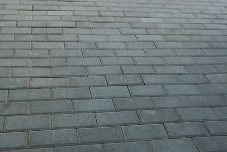 gray stone texture of paving slabs on the street 写真素材