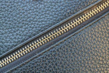 yellow zip fastener on a leather black bag Stockfoto