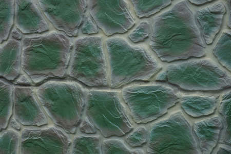 gray green stone texture of large cobblestones in the wall of the fence