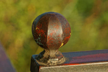 part of an iron decorative fence with a round detail with a tip of brown metal Stockfoto