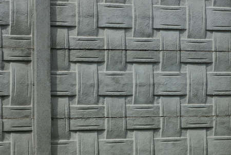 gray stone texture of patterned concrete wall fence Stockfoto