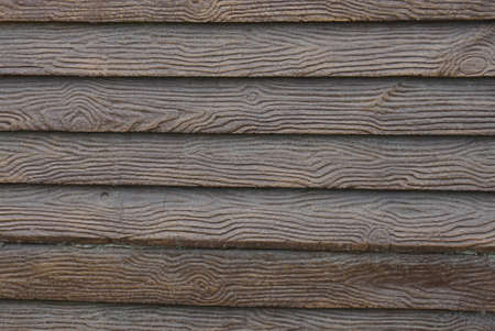 brown wood texture from decorative boards in the fence wall