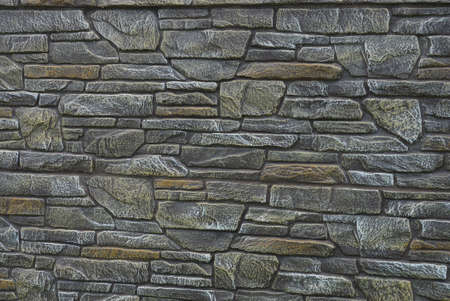 gray brown texture of stones in the wall of the fence