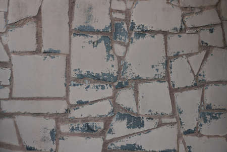 brown texture of shabby stones and tiles in an old wall Stockfoto