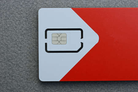 one chip on part white red paper card on gray table
