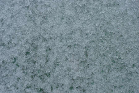 gray white natural texture of snow on a green board