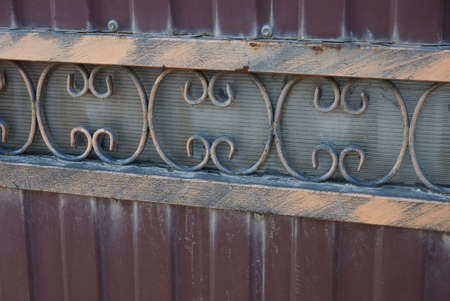 forged iron brown pattern metal texture on red iron fence wall