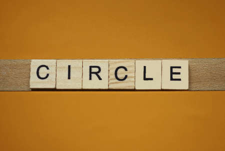 gray word circle made of wooden square letters on brown background Stockfoto - 163364594
