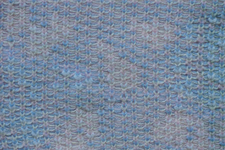 gray blue fabric texture from a colored piece of woolen cloth on clothes