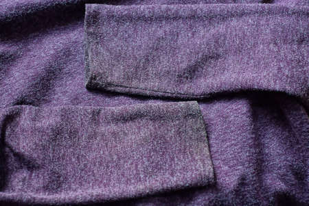 lilac fabric texture of dirty clothing sweater with two sleeves